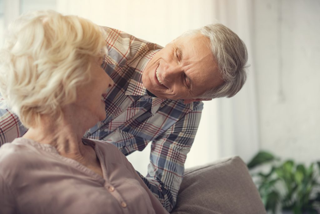 Senior man and woman looking at each other and smiling