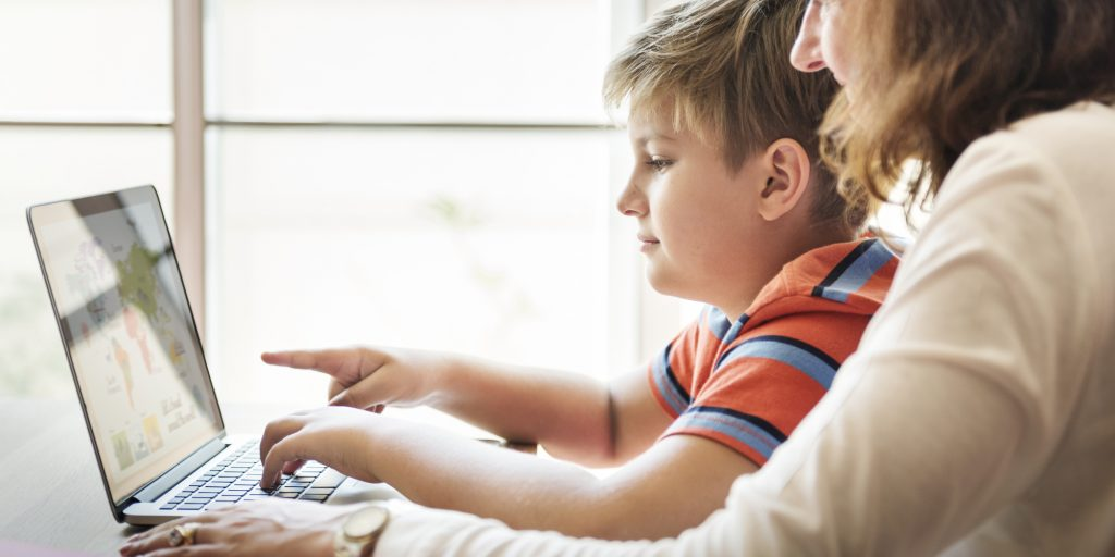 Mother and son with a laptop