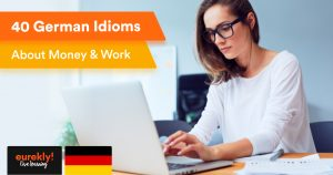 German idioms about money and work: Young woman of German origin working on her laptop to earn money