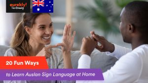 African man learning Auslan sign language with a female tutor