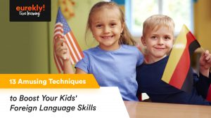 Kids learning foreign languages with flags in their hands