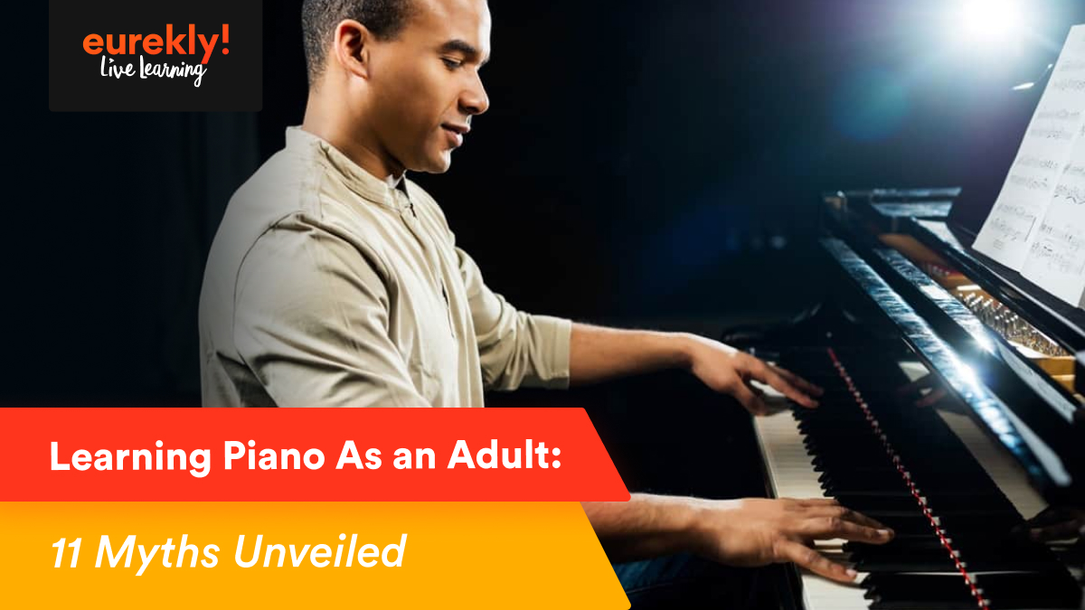 Young man learning to play the piano
